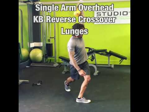Single Arm Overhead KB Reverse Crossover Lunges