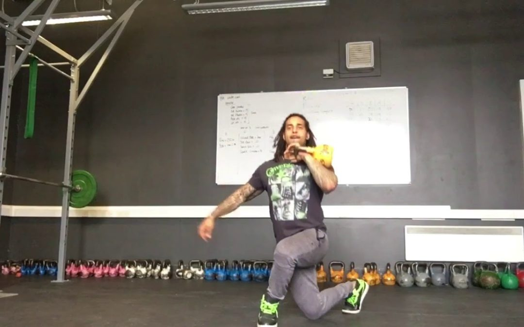 Single Arm Racked KB Reverse Crossover Lunges